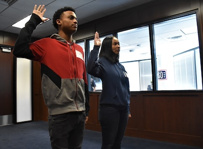 Marquis Butts (left) and his mother, Marva Burns (right), take the oath of enlistment, Oct. 8, Phoenix Military Entrance Processing Station. Both mother and son enlisted simultaneously in the U.S. Army. (U.S. Army Photo by Alun Thomas, Phoenix Recruiting Battalion Public Affairs)