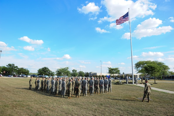Members of the National Air and Space Intelligence Center, Global Exploitation Intelligence Group conduct a Retreat Ceremony on Oct. 1, 2019 at Wright-Patterson Air Force Base, Ohio. A Retreat Ceremony serves a twofold purpose. It signals the end of the official duty day and serves as a ceremony for paying respect to the flag.