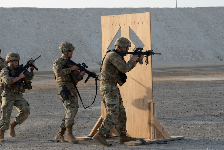 380th Expeditionary Security Forces Squadron Airmen fire from behind a barrier during a simunition proficiency firing course held on Al Dhafra Air Base, United Arab Emirates, Sept. 29, 2019.