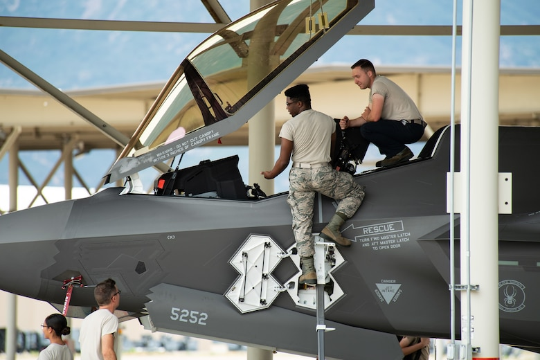Crew Chiefs with the 421st Aircraft Maintenance Unit work on an F35A Lightning II returning to Hill Air Force Base, Utah, July 31, 2019, after a two-month European deployment. The 421st Fighter Squadron participated in several combat exercises with allied and partner nations while deployed. (U.S. Air Force photo by R. Nial Bradshaw)
