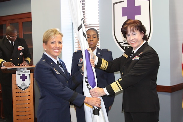 Brig. Gen. Shanna Woyak, Nevada Air National Guard, assumed authority of the National Capital Regional medical directorate from Rear Admiral Mary C. Riggs, left, during a ceremony at Walter Reed National Medical Center in Bethesda, Maryland, Oct. 9, 2019. Woyak, who served the past year as the Air National Guard advisor to the chief nurse of the U.S. Air Force, is the first Air National Guardsmen to lead the NCR medical directorate. (Photo by Bernard Little)