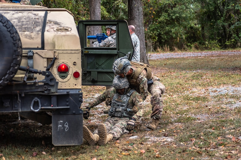 Senior Airman Daniel Boone, 23d Security Forces Squadron (SFS) installation patrolman, carries a simulated casualty during a field convoy operation Oct. 8, 2019, at Moody Air Force Base, Ga. The field convoy operation gave 23d SFS Airmen an opportunity to improve the ability to shoot, move and communicate, ensuring the Airmen are properly trained and prepared to carry out their mission in a contested environment. (U.S. Air Force photo by Airman 1st Class Taryn Butler)