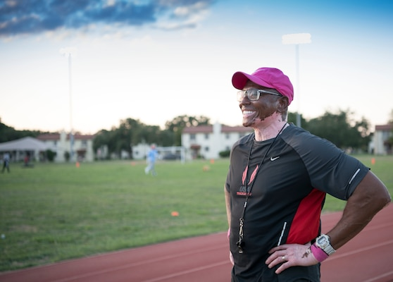 Tony Lightner pauses during track and field practice Oct. 2 at JBSA Randolph. Lightner, despite health hurdles, has trained kids in track and field for free since 2006.
