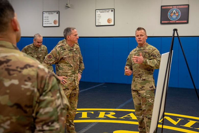 U.S. Air Force Tech. Sgt. Joshua Lipp, Phoenix Raven Qualification Course NCO in charge assigned to the 421st Combat Training Squadron, shares course history with Air Force Chief of Staff Gen. David L. Goldfein and Chief Master Sgt. of the Air Force Kaleth O. Wright during their visit to the U.S. Air Force Expeditionary Center as part of 2019 Fall Phoenix Rally, Oct. 9, 2019, at Joint Base McGuire-Dix-Lakehurst, New Jersey. Fall Phoenix Rally is a three-day summit focused on understanding leadership roles in emerging issues with Air Mobility Command, bringing together leadership and spouses from throughout the command