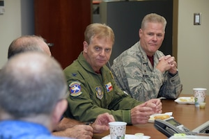 Cols. Paul Deschner, 433rd Aerospace Medicine Squadron, and Gregg Wentworth, 433rd Aeromedical Staging Squadron, listen to a discussion with honorary commanders during a tour of the 433rd Medical Group Oct. 5, 2019 at Joint Base San Antonio-Lackland, Texas.