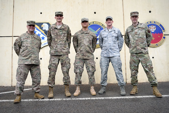 Captain James Henry, 694th Intelligence, Surveillance and Reconnaissance Group chaplain, (far left), Staff Sgt. Marcus Walker, 694th ISR religious affairs airman, (left), Tech. Sgt. Jin Lee, 694th ISRG medical technician, (middle), Master Sgt. Aaron Hurd, 694th ISRG mental health technician, (right), and Capt. Ryan Montanari, 694th ISRG psychologist, (far right) all make up the Airman Resiliency Team at Osan Air Base, Republic of Korea, and are tasked with the overall mental, physical and spiritual wellbeing of more than 500 Airmen and family members. In previous years, it had been noted that Airmen that worked in the intelligence career field were among the highest risk of suicide or suicide attempts, and this alarming trend led to the development of ARTs being imbedded in ISR groups across the Air Force as a constant resource for these Airmen. The teams consist of a mental health technician, a psychologist, chaplain, religious affairs Airman and a medical technician. (U.S. Air Force photo by Senior Airman Denise M. Jenson)