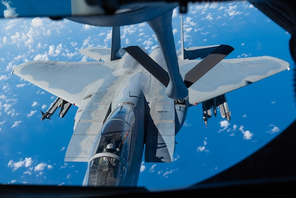 An F-15C Eagle from the 44th Fighter Squadron prepares to refuel with a KC-135 Stratotanker from the 909th Air Refueling Squadron Oct. 03, 2019, during a training exercise out of Kadena Air Base, Japan. Boom operators on a KC-135 have the ability to pump thousands of pounds of fuel to any capable aircraft, thousands of feet above the ground, flying at 230 miles per hour, while only 47 feet from the receiving aircraft. (U.S. Air Force photo by Senior Airman Cynthia Belío)