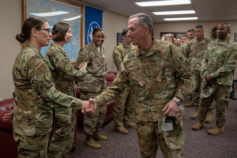 Air Force Chief of Staff Gen. David L. Goldfein presents a coin to U.S. Air Force Master Sgt. Bridget Baydal, logistics team sergeant assigned to the 818th Mobility Support Advisory Squadron, during their visit to the U.S. Air Force Expeditionary Center as part of 2019 Fall Phoenix Rally, Oct. 9, 2019, at Joint Base McGuire-Dix-Lakehurst, New Jersey. Fall Phoenix Rally is a three-day summit focused on understanding leadership roles in emerging issues with Air Mobility Command, bringing together leadership and spouses from throughout the command.