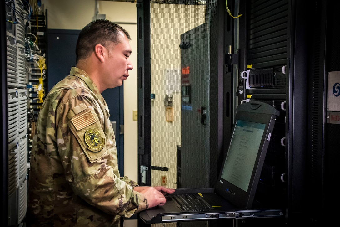 Photo of a military member working on a computer