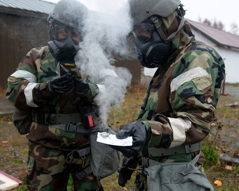 U.S. Airmen assigned to the 673d Air Base Wing use a chemical detection kit in a simulated hazardous environment during Polar Force 20-1 at Joint Base Elmendorf-Richardson, Alaska, Oct. 9, 2019. Designed to test JBER's mission readiness, Polar Force 20-1 is a two-week exercise that hones Airmen's skills and experience when facing adverse situations. Airmen refined their contingency tactics, techniques and procedures in support of the Pacific Air Force's Agile Combat Employment concept of operations. Agile Combat Support excellence yields multi-domain operations success. (U.S. Air Force photo by Airman 1st Class Emily Farnsworth)