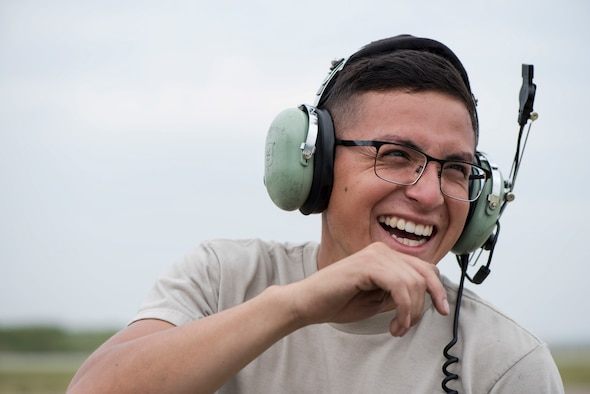 U.S. Air Force Senior Airman Gabriel Contreras, a 13th Aircraft Maintenance Unit crew chief, smiles during an aviation training relocation at Komatsu Air Base, Japan, Oct. 2, 2019. The ATR gave participants an opportunity to survey and experience the Komatsu airfield, while gaging their ability to operate in a simulated deployed location. (U.S. Air Force photo by Senior Airman Collette Brooks)