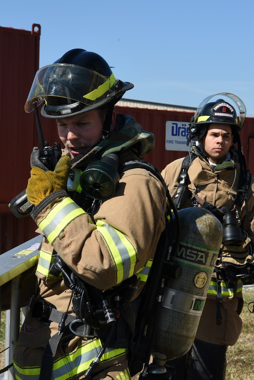 U.S. Air Force 8th Civil Engineer Squadron firefighters radio in about a fire during a training event at Kunsan Air Base, Republic of Korea, Oct. 9, 2019. The 8th CES firefighters train in multiple scenarios including plane incidents, car accidents and structure fires to be able to react to real world events. (U.S. Air Force photo by Staff Sgt. Joshua Edwards)