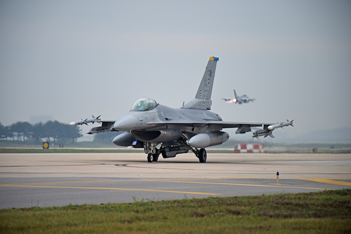 """A U.S. Air Force F-16 Fighting Falcon assigned to the 8th Operations Group prepares to take-off for a routine training flight at Kunsan Air Base, Republic of Korea, Oct. 10, 2019. The 8th OG has two F-16 squadrons including the 35th Fighter Squadron """"Pantons"""" and the 80th FS """"Juvats."""" (U.S. Air Force photo by Staff Sgt. Mackenzie Mendez)"""