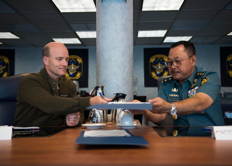 Vice Adm. Bill Merz, commander, U.S. 7th, Fleet signed minutes with Rear Adm. Didik Setiyono, Assistant Chief of Navy Indonesian Navy, aboard the U.S. 7th Fleet flagship, USS Blue Ridge (LCC 19), during staff talks with the Indonesian Navy, October 11, 2019. The Indonesian Navy's visit to U.S. 7th Fleet headquarters is highlighted by this year's marking of the 70th anniversary of diplomatic ties between the United States and Indonesia.