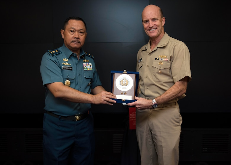 191011-N-CN315-0012 YOKOSUKA, Japan (Oct. 11, 2019) - Vice Adm. Bill Merz, commander, U.S. 7th, Fleet, exchanges gifts with Rear Adm. Didik Setiyono, Assistant Chief of Navy Indonesian Navy, aboard the U.S. 7th Fleet flagship, USS Blue Ridge (LCC 19), during staff talks with the Indonesian Navy, October 11, 2019. The Indonesian Navy's visit to U.S. 7th Fleet headquarters is highlighted by this year's marking of the 70th anniversary of diplomatic ties between the United States and Indonesia. (U.S. Navy photo by Mass Communication Specialist 2nd Class Jimmy Ong)