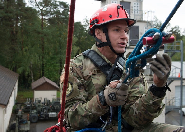 U.S. Air Force Staff Sgt. Robert Wellborn, 435th Construction and Training Squadron fire rescue and contingency training instructor, prepares to descend from the top of Building 715 at the 435th CTS compound near Ramstein Air Base, Germany, Oct.10, 2019. During this rescue maneuver, firefighters slowly descend to a suspended victim while maintaining control of themselves, even at dangerous heights.