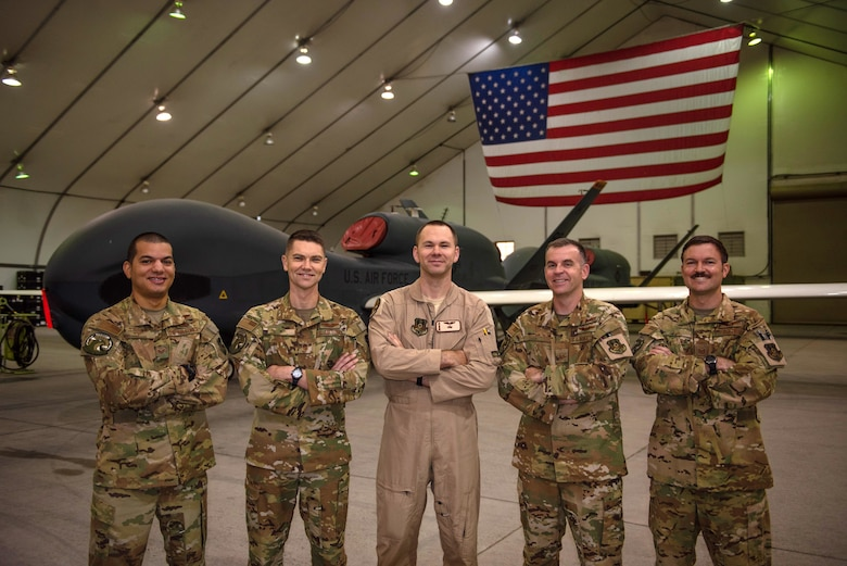 Enlisted RQ-4 Global Hawk crew members pose for a photo Oct. 10, 2019, at Al Dhafra Air Base, United Arab Emirates. For the first time downrange, an all-enlisted crew launched and recovered an RQ-4s to perform operations out of Al Dhafra Air Base, United Arab Emirates, Sept. 13, 2019. (U.S. Air Force photo by Staff Sgt. Chris Thornbury)