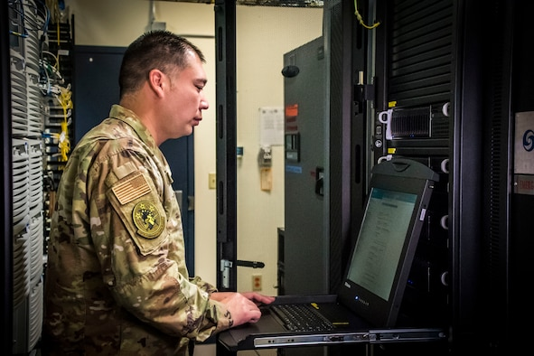 U.S. Air Force Senior Master Sgt. Nick Wirwille, the superintendent of the cyber systems operations shop assigned to the Communications Squadron at the 179th Airlift Wing, Ohio Air National Guard, works on a computer Oct. 6, 2019, at the 179th AW in Mansfield, Ohio. Cyber systems operations specialists design, install and support systems to ensure they operate properly and remain secure from outside intrusion. (U.S. Air National Guard photo by Airman 1st Class Alexis Wade)