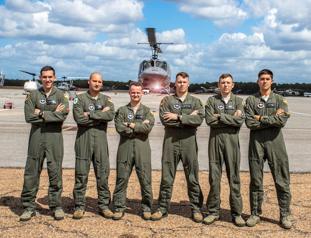 (From left to right) U.S. Air Force students 1st Lt. Matthew Gulotta, 2nd Lt. Trent Badger, 2nd Lt. Richard Songster, 2nd Lt. John Michael Thrash, Capt. Josh Park and 2nd Lt Karl Bossard stand in front of a TH-1H helicopter at Fort Rucker, Ala., Oct. 10, 2019. All six officers graduated from Specialized Undergraduate Pilot Training - Helicopter Class 20-02, which incorporated virtual reality in an experimental curriculum that resulted in the class graduating six weeks earlier than normal training classes while reducing actual flying time in the TH-1H by about 35%. (U.S. Air Force courtesy photo/Brian Braden)