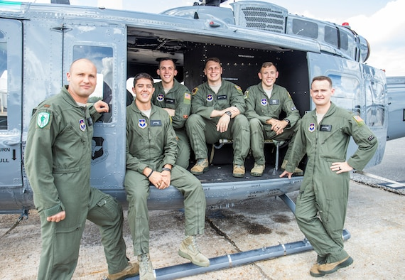 (From left to right) U.S. Air Force students 2nd Lt. Trent Badger, 2nd Lt. J. Karl Bossard, 1st Lt. Matthew Gulotta, 2nd Lt. John Thrash, Capt. Josh Park, and 2nd Lt. Richard Songster with a TH-1H helicopter at Fort Rucker, Ala., Oct. 10, 2019. All six officers graduated from Specialized Undergraduate Pilot Training - Helicopter Class 20-02, which incorporated virtual reality in an experimental curriculum that resulted in the class graduating six weeks earlier than normal training classes while reducing actual flying time in the TH-1H by about 35%. (U.S. Air Force courtesy photo/Brian Braden)