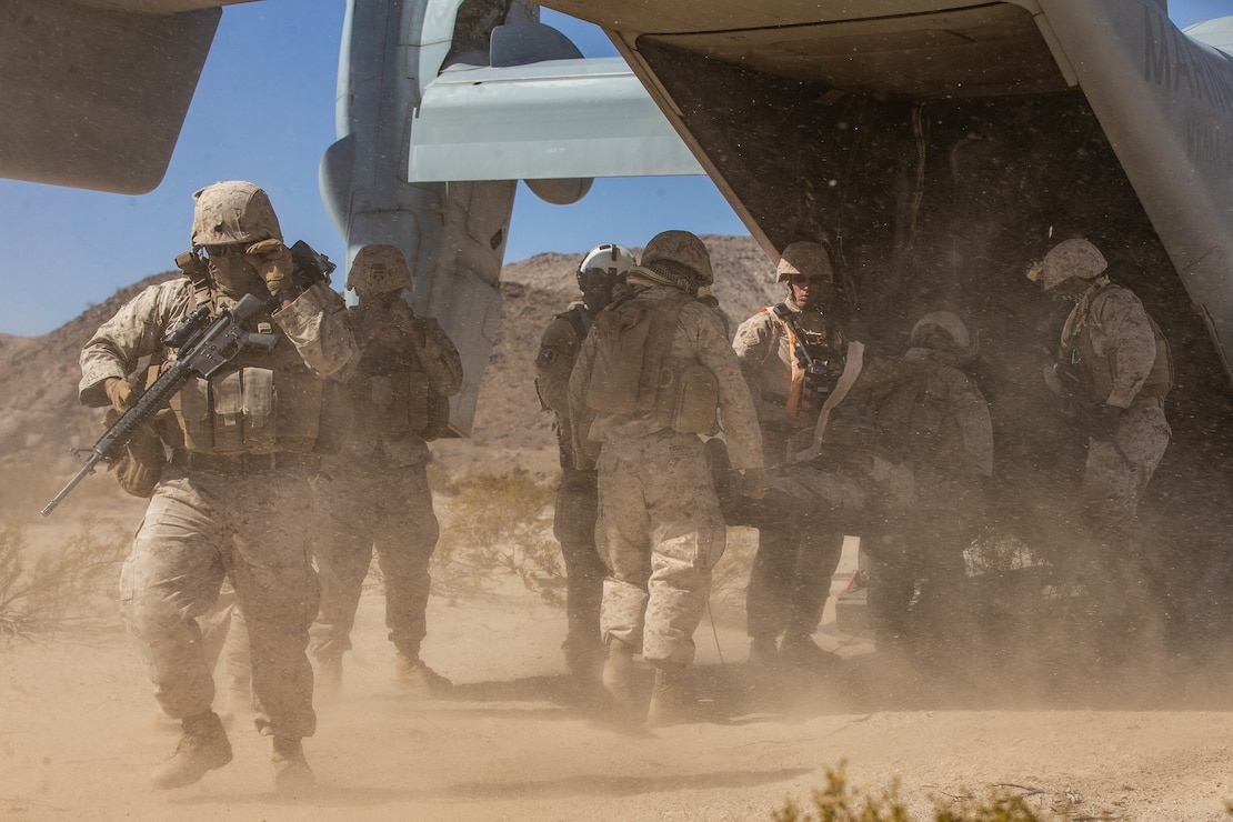 U.S. Marines with Combat Logistics Battalion 8, Combat Logistics Regiment 2, 2nd Marine Logistics Group, carry simulated casualties to a MV-22 Osprey during motorized operations course as part Integrated Training Exercise 1-20 on Marine Corps Air Ground Combat Center Twentynine Palms, California, Oct. 6, 2019. CLB 8 integrated with 2nd Marine Regiment during ITX to provide direct support and tactical logistics beyond the regiment's organic capabilities in the areas of transportation, field level maintenance, and general engineering.