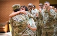 U.S. Army Reserve Capt. Adriana Scott, a force protection officer with the 98th Training Division (Initial Entry Training), was promoted to the rank of major by Brig. Gen. Tony Wright, commanding general, during a ceremony at the U.S. Army Reserve Center at Fort Benning, Georgia, on Oct. 5, 2019. Scott has served in both the Army and Army Reserve for more than 17 years, which includes two deployments to Iraq. The Soldier migrated to the United States with her parent when she was 3-years-old and was inspired to join the Army after the September 11th attacks because she felt the need to do her part and help protect the country that had given her family so much. While saying a few words to the formation, Scott's mother, Celia, got to hug her daughter while she was explaining why she joined and how thankful she was that her parents migrated to the United States when she was young so that she could find this career.