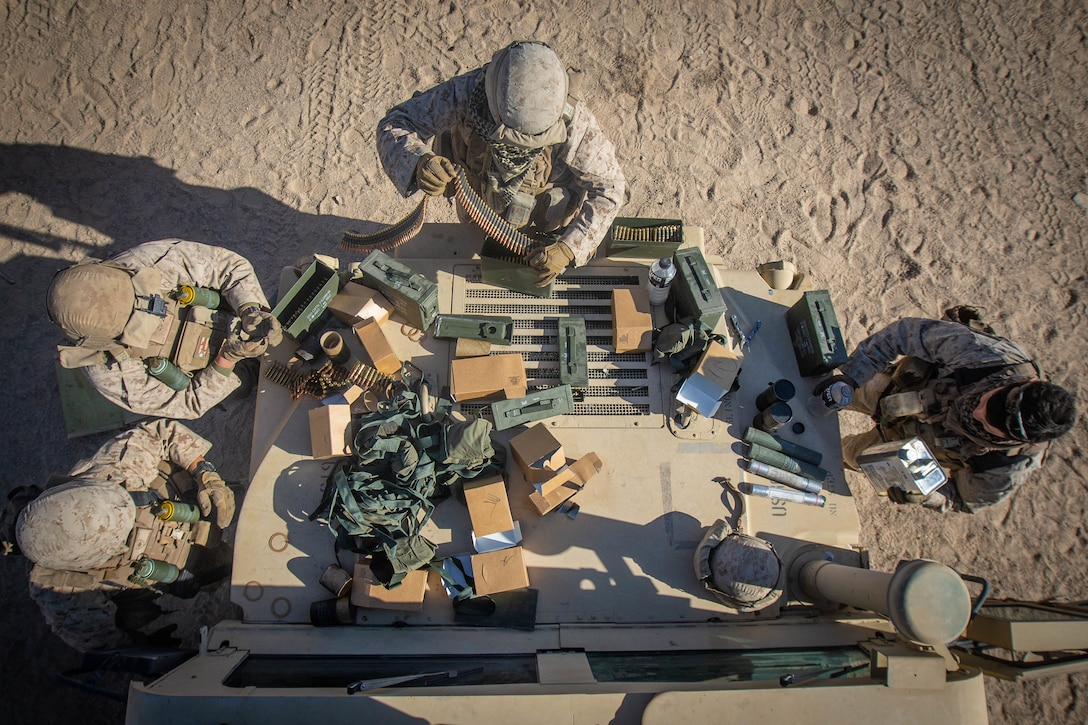 U.S. Marines with Combat Logistics Battalion 8, Combat Logistics Regiment 2, 2nd Marine Logistics Group, prepare ammunition before the motorized operations course as part Integrated Training Exercise 1-20 on Marine Corps Air Ground Combat Center Twentynine Palms, California, Oct. 6, 2019. CLB-8 integrated with 2nd Marine Regiment during ITX to provide direct support and tactical logistics beyond the regiment's organic capabilities in the areas of transportation, field level maintenance, and general engineering.