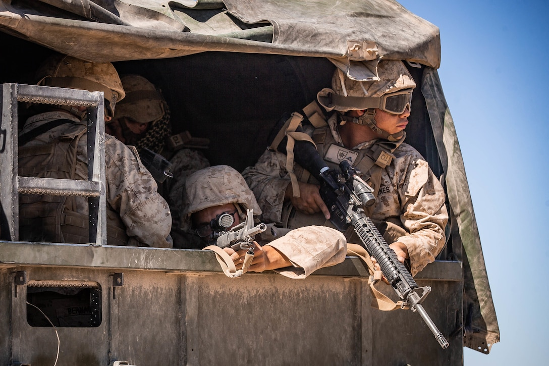 U.S. Marines with Combat Logistics Battalion 8, Combat Logistics Regiment 2, 2nd Marine Logistics Group, provide security out of the back of a Medium Tactical Vehicle Replacement during motorized operations course as part Integrated Training Exercise 1-20 on Marine Corps Air Ground Combat Center Twentynine Palms, California, Oct. 6, 2019. CLB-8 integrated with 2nd Marine Regiment during ITX to provide direct support and tactical logistics beyond the regiment's organic capabilities in the areas of transportation, field level maintenance, and general engineering.