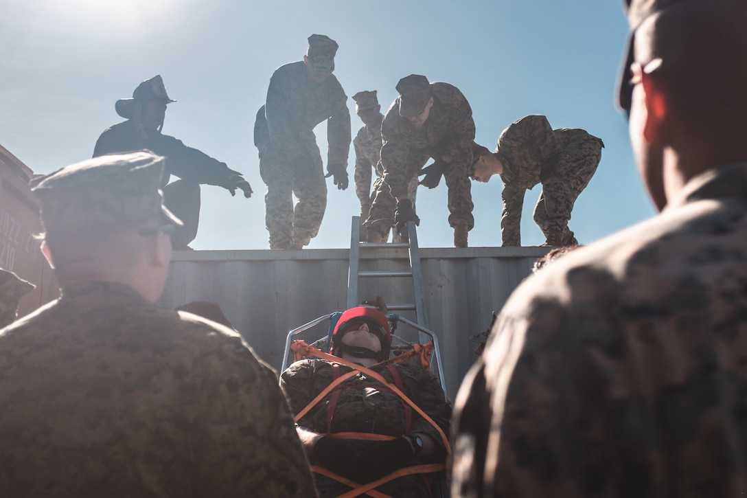 U.S. service members with Task Force San Francisco participate in an urban search and rescue exercise hosted by the San Francisco Fire Department at the SFFD Training Center on Oct. 8, 2019. San Francisco Fleet Week is an opportunity for the Marine Corps to learn more about emergency response needs and to share their crisis response skills with civil authorities to enhance their emergency response capabilities.