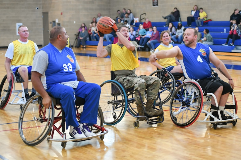 Major Michael Twining, 75th Security Forces Squadron commander, shoots the ball during a wheelchair basketball game Oct. 9, 2019 at Hill Air Force Base, Utah. Leaders from Hill's units faced off against the Ogden Wheelin' Wildcats, a semi-professional wheelchair basketball team, to celebrate National Disability Employment Awareness Month. (U.S. Air Force photo by Cynthia Griggs)