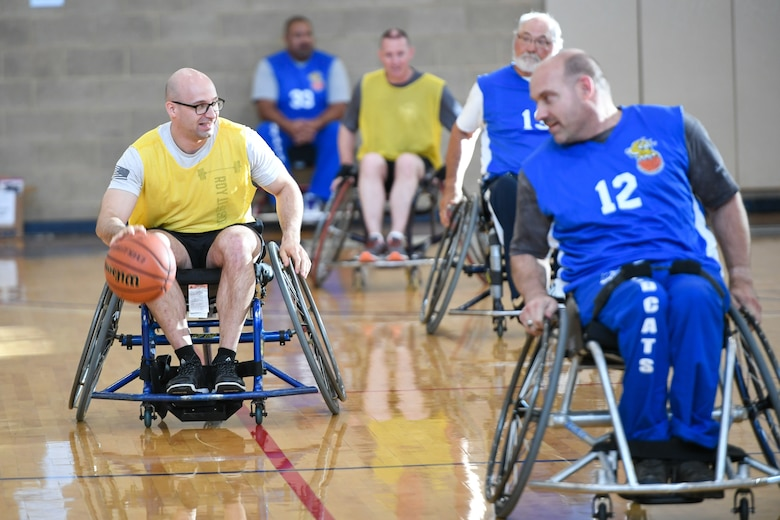 Master Sgt. Albert Lamboy, 75th Logistics Readiness Squadron acting first sergeant, dribbles the ball during a wheelchair basketball game Oct. 9, 2019 at Hill Air Force Base, Utah. Leaders from Hill's units faced off against the Ogden Wheelin' Wildcats, a semi-professional wheelchair basketball team, to celebrate National Disability Employment Awareness Month. (U.S. Air Force photo by Cynthia Griggs)