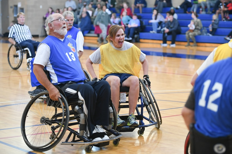 Colonel Regina Sabric, 419th Fighter Wing commander, cheers as a co-player scores a basket during a wheelchair basketball game Oct. 9, 2019 at Hill Air Force Base, Utah. Leaders from Hill's units faced off against the Ogden Wheelin' Wildcats, a semi-professional wheelchair basketball team, to celebrate National Disability Employment Awareness Month. (U.S. Air Force photo by Cynthia Griggs)