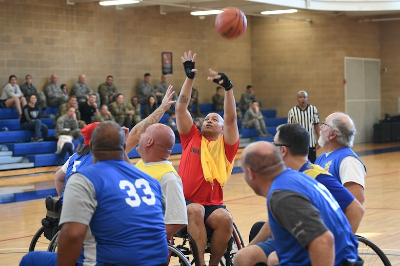 A member from Team Hill shoots the ball during a wheelchair basketball game Oct. 9, 2019 at Hill Air Force Base, Utah. Leaders from Hill's units faced off against the Ogden Wheelin' Wildcats, a semi-professional wheelchair basketball team, to celebrate National Disability Employment Awareness Month. (U.S. Air Force photo by Cynthia Griggs)