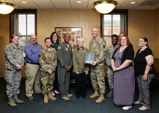 Col. Gavin Marks, 55th Wing commander and Chief Master Sgt. Brian Thomas, 55th Wing command chief, presents the 2018 Air Force Resource Management Flight of the Year award Oct. 4, 2019,  inside the 55th Mission Support Group headquarters.