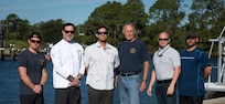 A team from Naval Surface Warfare Center Panama City Division provided lifesaving assistance after a multi-vehicle accident September 26.