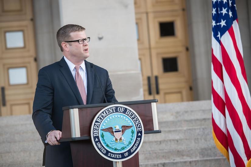 Army Secretary Ryan D. McCarthy speaks at a lectern.