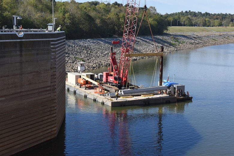 Fish Guidance Systems crew prepares to install a section of the bio acoustic fish fence Oct. 9, 2019 on the riverbed below Barkley Lock in Grand Rivers, Ky. The BAFF is expected to be operational in a few weeks, and a field trial is set to test the effectiveness.  The project involves multiple agencies and partners, including U.S. Fish and Wildlife Service, Kentucky Department of Fish and Wildlife Resources, U.S. Army Corps of Engineers Nashville District, U.S. Geological Survey and Tennessee Wildlife Resources Agency. (USACE photo by Lee Roberts)