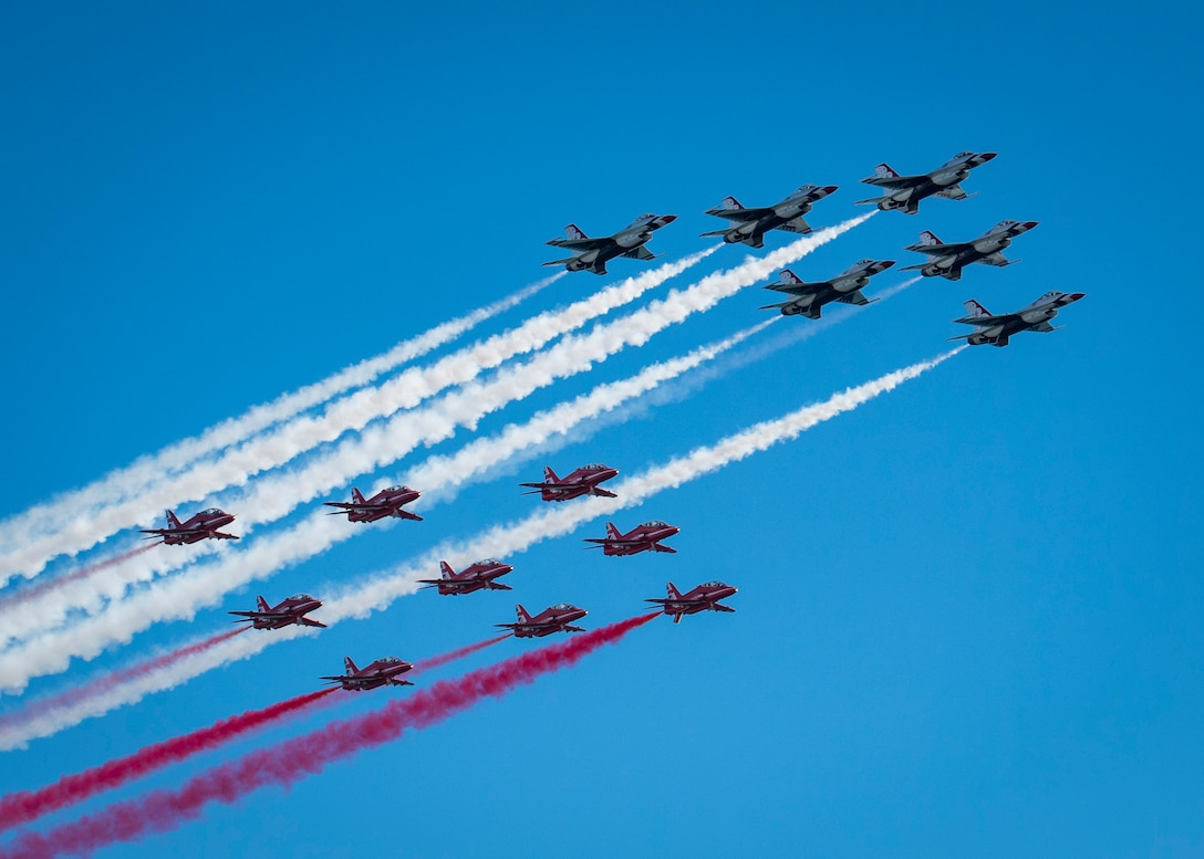 """The United States Air Force Air Demonstration Squadron """"Thunderbirds"""" perform a fly-by with the Royal Air Force Red Arrows Oct, 6, 2019, during the Great Pacific Air Show at Huntington Beach, Calif. (U.S Air Force Photo by Maj. Ray Geoffroy)"""