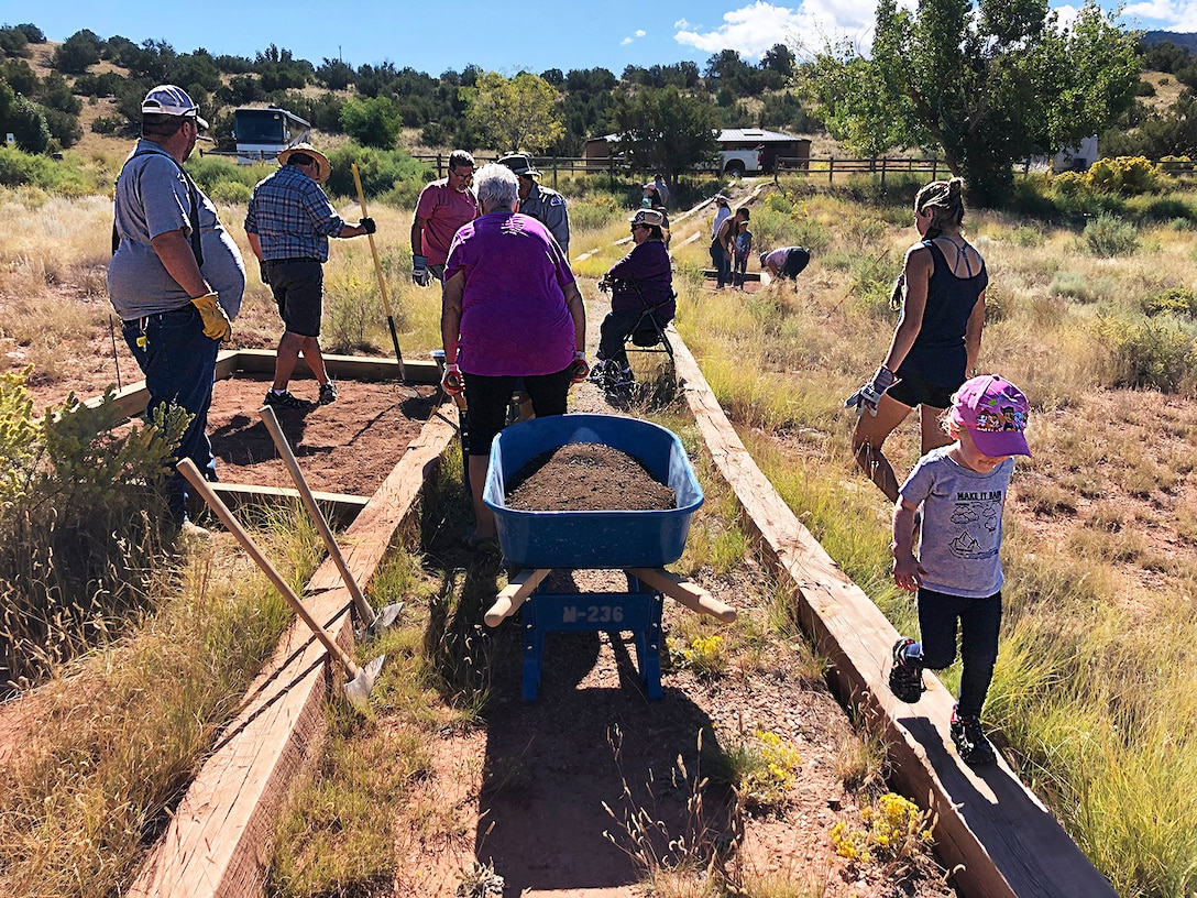 Volunteers create a new pollinator garden and pathway at Abiquiu Lake during National Public Lands Day, Sept. 28, 2019.
