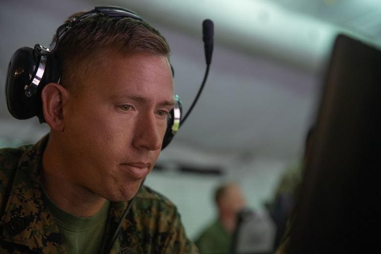 Gunnery Sgt. Zachary S. Crone executes a communications check during Exercise Pegasus Flight at Marine Corps Air Station Cherry Point, North Carolina, Oct. 1, 2019. Marine Tactical Air Command Squadron 28 supported Pegasus Flight by planning, commanding, directing and supervising all air operations as the tactical air command center for the exercise. Crone is a tactical air defense controller with MTACS-28, Marine Air Control Group 28, 2nd Marine Aircraft Wing. (U.S. Marine Corps photo by Pfc. Steven M. Walls)