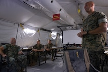 Marines attached to Marine Tactical Air Command Squadron 28 discuss future operations during Exercise Pegasus Flight at Marine Corps Air Station Cherry Point, North Carolina, Oct. 1, 2019. MTACS-28 supported Pegasus Flight by planning, commanding, directing and supervising all air operations as the tactical air command center for the exercise. MTACS-28 is a part of Marine Air Control Group 28, 2nd Marine Aircraft Wing. (U.S. Marine Corps photo by Pfc. Steven M. Walls)