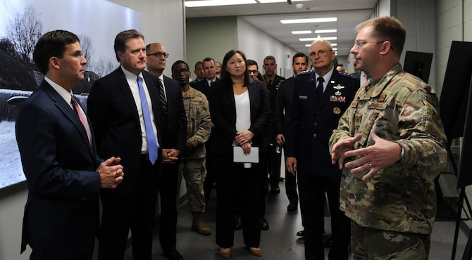Col. Parker Wright, National Air and Space Intelligence Center commander, briefs Secretary of Defense Dr. Mark T. Esper during his visit to Wright-Patterson Air Force Base, Ohio on Oct. 4, 2019. While at NASIC, Esper also met with Airmen from the center's Foreign Materiel Exploitation Squadron.