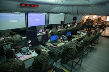 Marines assigned to Marine Tactical Air Command Squadron 28 await orders in the unit's command center during Exercise Pegasus Flight at Marine Corps Air Station Cherry Point, North Carolina, Oct. 1, 2019. MTACS-28 supported Pegasus Flight by planning, commanding, directing and supervising all air operations as the tactical air command center for the exercise. MTACS-28 is a part of Marine Air Control Group 28, 2nd Marine Aircraft Wing. (U.S. Marine Corps photo by Pfc. Steven M. Walls)