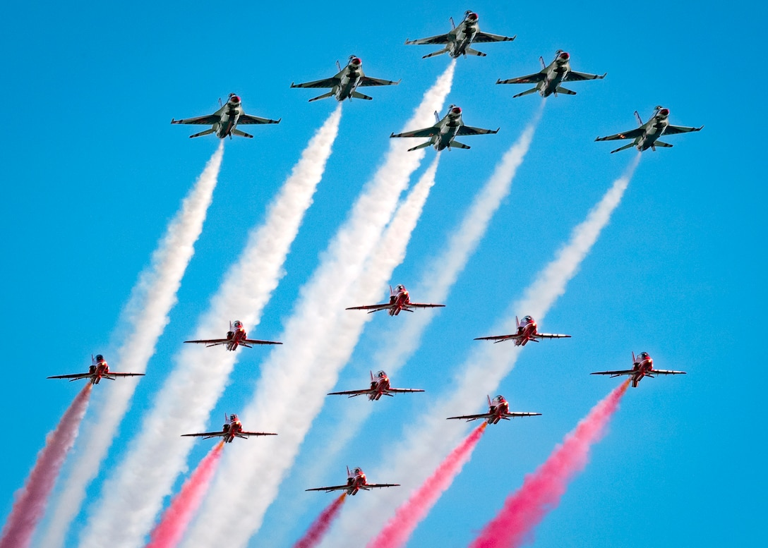 Thunderbirds and the Royal Air Force Red Arrows fly a 15-ship parade-style flat pass