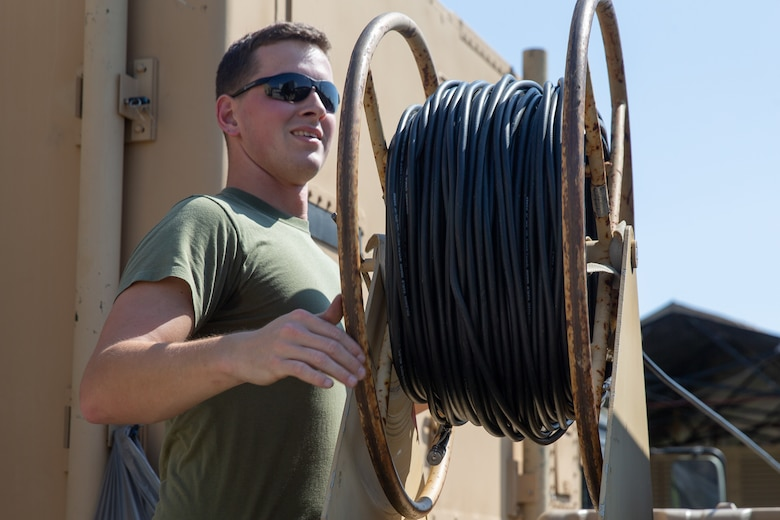Marine Sgt. Nicholas A. Ashman secures network cables for transport during Exercise Pegasus Flight at Marine Corps Air Station Cherry Point, North Carolina, Oct. 2, 2019. Marine Air Control Squadron 2 supported Pegasus Flight by providing air surveillance, airspace management, identifying and classifying radar tracks as the tactical air operations center for the exercise. Ashman is an aviation communication systems technician with MACS-2, Marine Air Control Group 28, 2nd Marine Aircraft Wing, (U.S. Marine Corps photo by Pfc. Steven M. Walls)