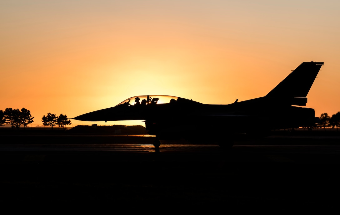 An F-16 Fighting Falcon taxis down the runway