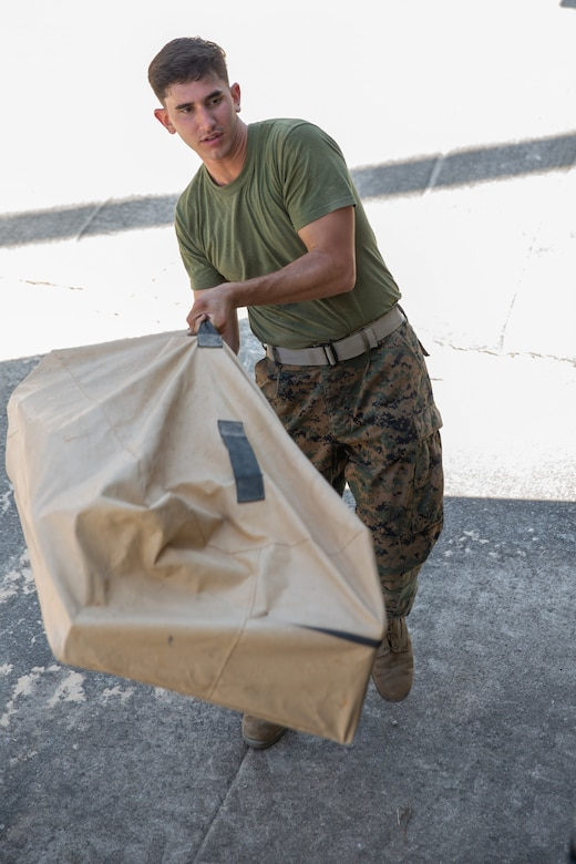 Marine Cpl. Jonathan L. Perez packs up a communications system during Exercise Pegasus Flight at Marine Corps Air Station Cherry Point, North Carolina, Oct. 2, 2019. Marine Air Control Squadron 2 supported Pegasus Flight by providing air surveillance, airspace management, identifying and classifying radar tracks as the tactical air operations center for the exercise. Perez is an engineer equipment electrical systems technician with MACS-2, Marine Air Control Group 28, 2nd Marine Aircraft Wing. (U.S. Marine Corps photo by Pfc. Steven M. Walls)