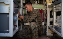 Marine Cpl. Brandon R. Rusch changes frequencies on a radio during Exercise Pegasus Flight at Marine Corps Air Station Cherry Point, North Carolina, Oct. 2, 2019. Marine Air Communications Squadron 2 supported Pegasus Flight by providing air surveillance, airspace management, identifying and classifying radar tracks as the tactical air operations center for the exercise. Rusch is an aviation communications systems technician with MACS-2. (U.S. Marine Corps photo by Pfc. Steven Walls)