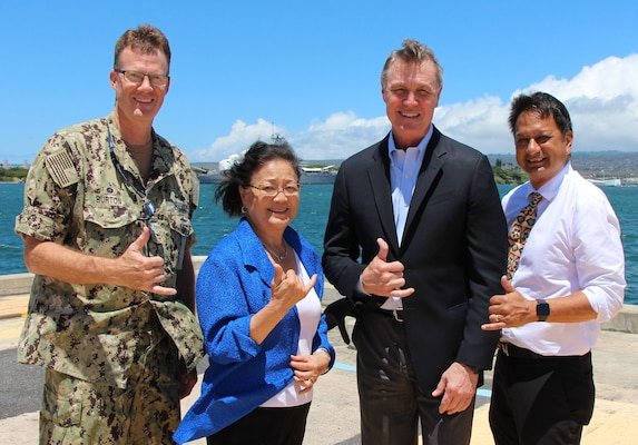 Commander of Pearl Harbor Naval Shipyard and Intermediate Maintenance Facility Capt. Greg Burton (left), Sen. Mazie Hirono of Hawaii, Sen. David Perdue, and Nuclear Engineering & Planning Manager Kaipo Crowell (Right) overlooking the USS Arizona Memorial and Battleship Missouri Memorial.