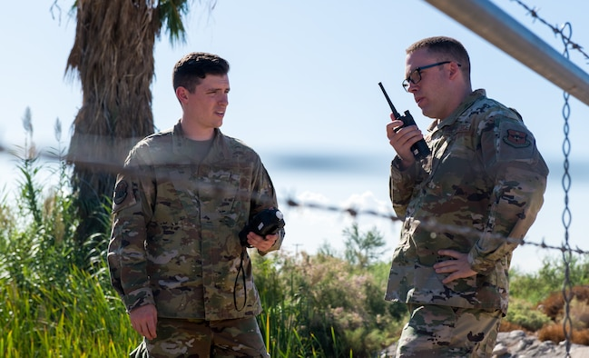 Senior Airman Joseph Bahr (left), 56th Aeromedicine Squadron bioenvironmental technician, and Staff Sgt. Eric Roberts, 56th Aeromedicine Squadron noncommissioned officer in charge of Radiation and Safety Operations Element, monitor volatile organic compounds in the air during a fuel spill exercise Oct. 4, 2019, at Luke Air Force Base, Ariz.
